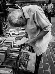 Read & Repeat (pxlline) Tags: lviv books christmas ukraine candid street