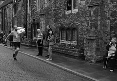 Running with Potatoes (Bury Gardener) Tags: ely cambridgeshire england eastanglia uk britain bw blackandwhite monochrome mono 2018 nikond7200 nikon street streetphotography streetcandids snaps candid candids people peoplewatching folks strangers