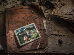 Today's Lesson (Siobhán Bermingham) Tags: naturallight atlas abandoned schoolbook decay ireland old house communion deserted irish school children photograph