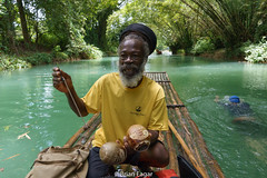 Jamaican raft captain (brian eagar - very busy - not much time to comment) Tags: jamaica gourd raft river handmade handcarved rasta