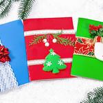 Cheerful handmade Christmas card on winter new year background thumbnail