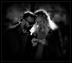 Decision Time (ronramstew) Tags: couple man woman phone bw blackandwhite dundee scotland candid streetphotography sonyrx100