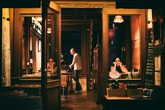 Driking alone with my reflection (Marta Marcato) Tags: woman drink drinking spritz girl bar venice venezia reflection night lonely alone solo door glass window light nikond7200 italy italia eyes eye hands portrait street streetphotography