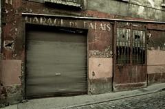Je suis sensible à ces restes d'une autre époque... (woltarise) Tags: lyon garage abandonné decay métal rouille couleurs ricohgr vieuxlyon france bâtiment