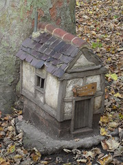 Fairy house (Nekoglyph) Tags: danby yorkshire nationalpark moors visitor centre green trees nature fairy house cottage timbered leaves autumn trunk roof tiles chimney cute magic