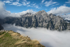 The weather forecast is usually wrong :) (LB1415) Tags: valley alps ridge rocks september autumn fog pentax k200d rawtherapee blue sky walking julianalps slovenia europe lb1415 allrightsreserved cloud landscape nature mountaintop equinox mountain interesting atmosphere debelapeč rjavina jesen wow