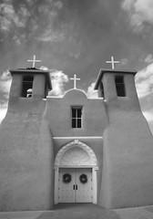New Mexico Church (WILSON-53) Tags: courtyard dogs sky indian adobe clouds cross mountains desert anseladams newmexico black white church old taos
