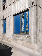 Au Dépanneur Beau-Prix, at the Good Price Convenience Store. (Tim Kiser) Tags: 1970s 1970sarchitecture 1970sbuilding 1976 1976architecture 1976building 2018 20180531 beauprix canada dépanneurbeauprix img9235 islandofmontréal lepierce may may2018 montréal montréalcanada montréalquébec montréalquébeccanada québec ruepierce shaughnessyvillage shaughnessyvillageneighborhood urbanagglomerationofmontréal villemarie blue blueandgold brutalism brutalistarchitecture brutalistbuilding buildingcorner businesssign concrete concretebuilding concreteconstruction conveniencestore corner damage damagedconcrete dépanneur formervines gold goodprice goodpriceconveniencestore noareacode phonenumber removedvines shopsign sign southquébec southernquébec southwestquébec southwesternquébec sunny telephonenumber transparentletters vinedamage vines windowsign îledemontréal