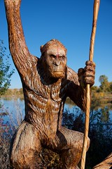 Menacing Park Native (The Good Brat) Tags: colorado us sculpture wood carving chainsaw primate ape spear art pond craig loudysimpsonpark