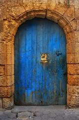 questions (ghadamohammed2004) Tags: egypt cairo oldcairo moezstreet oldegypt doors blue wall cracks texture bricks yellow old oldbutgold