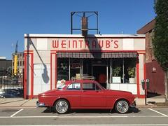 1967 Volvo at Weintraub's Delicatessen. (63vwdriver) Tags: porcelainenamel vintagestorefront massachusetts mass ma worcester delicatessen weintraubs volvo amazon 122 122s red 2 door sedan
