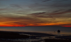 Floating in Afterglow (brucetopher) Tags: sunset red water sea ocean bay coast seacoast beach sun set setting afterglow twilight night sky cloud clouds painterly painted evening fall autumn fire fiery fireinthesky skies