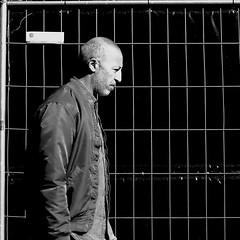 In front of the screen door (pascalcolin1) Tags: paris13 homme man porte door grillage screen photoderue streetview urbanarte noiretblanc blackandwhite photopascalcolin canon canon50mm 50mm