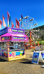 🎠Carnival Time🎡 (SurFeRGiRL30) Tags: carnival ferriswheel colorful colourful pink blue sun sunny sunshine beautifulday flags signs snowcones popcorn lemonade food foodvendors colddrinks icecream fun