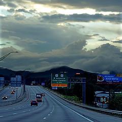 Asheville, North Carolina, USA (pom'.) Tags: panasonicdmctz101 july 2018 northcarolina usa unitedstatesofamerica america northamerica appalachia appalachianmountains asheville buncombecounty roadpicture cars twilight dusk sky clouds mountains fromamovingvehicle 100 200 300