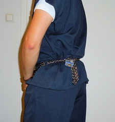 jail hopping: different facilities, different clothing, different restraints (rainerzufall1234) Tags: handcuffs handcuffed inmate uniform prisoner jail bellychain restraint padlock
