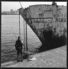 shipwreck and fisherman (ukke2011) Tags: hasselblad503cw planarcfe8028 spur50dsx agfa copex rodinal 150 selfdeveloping bw blackandwhite monochrome bianconero 120 6x6 square analog analogico harbor porto sea mare fischerman pescatore