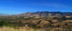 Research Ranch, Coronado National Forest, Cochise County, Arizona (edk7) Tags: nikond3200 edk7 2013 usa arizona cochisecounty theresearchranch coronadonationalforest internationalunionforconservationofnature iucn iucncategoryvi landscape scrubland hill mountain sky vista grass valley erosion geology rock tree