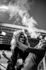 I love the way you blow. (ceruleansnake) Tags: atx austin tx club tuesgayz night life nightlife downtown queer transvestite cross dresser dressing guy man woman wig cigarette smoke blowing standing portrait makeup lipstick mustache black white bw impress hair bnw