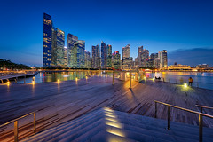 Evening Blues (Scintt) Tags: singapore mbs marina bay water sky dramatic travel tourist attraction exploration movement motion skyline cityscape city urban modern structures architecture buildings offices shenton way cbd scintillation scintt jonchiangphotography iconic surreal epic wideangle still calm glow light tones nature pond pool dusk twilight waterfront longexposure slowshutter bluehour boat quay clarke bridge panorama pano stitched trails hotel office towers skyscrapers rafflesplace wide night evening haida neutraldensity sigma art 1224 financial business centralbusinessdistrict