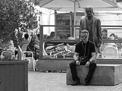 It follows (Andy WXx2009) Tags: monochrome blackandwhite almeria streetphotography candid urban statue man people outdoors spain espana europe city sitting bench style street fashion funny sunglasses male cigarette smoking
