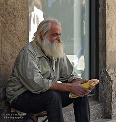 the big sandwich (gabi lombardo) Tags: man uomo anziano mann people mano hand panino brot sandwich barba bart beard finestra fenster window sitting riflessi spiegelungen reflections wand wall muro