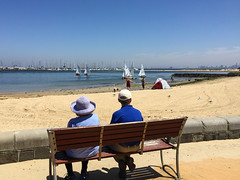 Watching the action (Marian Pollock) Tags: australia victoria brighton beach yachtclub seat cople watching sailing sailboats marina children pier sitting shadows tent child shallows skyline