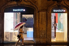 Time is watching you   Rome (eyenamic) Tags: umbrella shop watch swatch rome italy streetphotogarphy streets walk window nikon d5100 walker