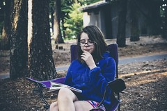 Camping at Link Creek (pete4ducks) Tags: evie evangeline child girl kid oregon 2018 summer vacation travel matte cropped on1pics raw sony mirrorless linkcreekcampground reading centraloregon blue book purple trees glasses