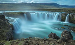 Godafoss (UnchartedLens) Tags: waterfall water iceland landscape rock mountain tree sky long exposure flowing travel destinations seascape falls color