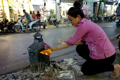 Store owner making monthly good luck offerings. Hanoi, Vietnam. (bwaters23) Tags: travel asia vietnam hanoi leica q