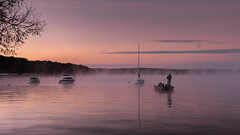 Misty Angler (mark-marshall) Tags: sunrise fisherman lakegenevawi colors fall reflections boats silhouette hss heat