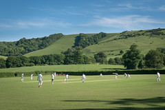 Cricket under the Downs (tom ballard2009) Tags: forestrow green middletonmanor streatwestmeston sussex westmeston cricket field game grass sport southdowns south downs landscape blue