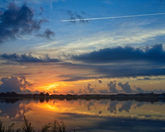 Sunrise Flight (DASEye) Tags: davidadamson daseye nikon sunrise dawn contrails contrail reflected reflections reflection lake