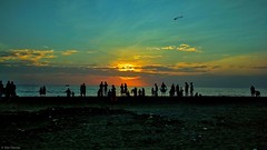 Sunset (dan-george) Tags: sunset beach kite water sky blue yellow red people evening sea grass