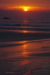 3KB07842a_C (Kernowfile) Tags: cornwall stives porthmeorbeach sunset water reflections rocks cliffs sand pentax