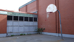 Old, sad, decrepit schoolyard basketball court (Coastal Elite) Tags: decrepit basketball court rusted hoops rim basket sport schoolyard backboard board old torn net facilities installation rusty oxfordschool halifax novascotia oxford school westend école education elementary empty outdoor summer abandoned deserted vacant outside urban pavement sad brick wall