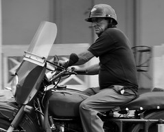 Make Do and Mend. (Cuba). (Neil. Moralee) Tags: neilmoralee man motorcycle helmet bike biker rider ride cuba havana old mature black white bw bandw blackandwhite nikon d5000 neil moralee street candid windscreen mend bodge fix