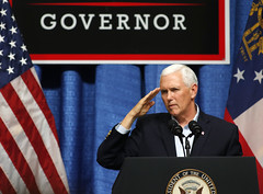 Vice President Mike Pence salutes members and veterans of the military at a rally for gubernatorial candidate Brian Kemp at the Columbia County Exhibition Center in Grovetown, Ga. Pence's son, Michael Pence, is a United States Marine. (Photo/Vira Halim)