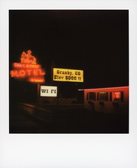 Trail Riders Neon 1 (tobysx70) Tags: polaroid originals color 600 instant film slr680 trail riders neon east agate avenue granby colorado co sign lit illuminated night nocturnal horse cowboy glow handheld red motel no vacancy wifi 8000 ft polaradoone polarado 072118 toby hancock photography