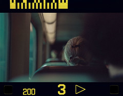 Riding The Metra (Jovan Jimenez) Tags: canon eos ix ef 50mm stm voigtlander vxg 200 aps film metra metro train cinematic analog analogue grain 16x9 widescreen plustek opticfilm 8200i