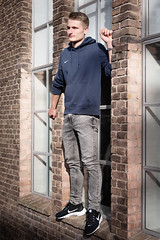 Rick on window sill (Dannis van der Heiden) Tags: modelfotografie modelphotography model boy building brickbuilding windowstill window sneekers jeans sweater amersfoort netherlands nikond750 d750 nikkor50mmf18g 50mm bricks wagenwerkplaats