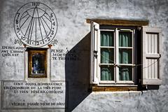Le cadran solaire (Lucille-bs) Tags: europe france auvergnerhônealpes hauteloire blesle cadransolaire fenêtre mur façade écriture ombre lumière volet