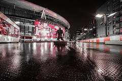 In the shadow of a legend red edit (Paul Wrights Reserved) Tags: arsenal football footbalclub arsenalstadium building iconic iconicbuilding selective night nightphotography nighttime darkness light