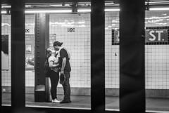 50 (John St John Photography) Tags: kissing streetphotography candidphotography ctrain 50th street subwaystation mta newyorkcity newyork lovers embrace bw blackandwhite blackwhite blackwhitephotos johnstjohnphotography