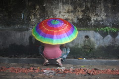 The LGBTQ Urinary Movement (N A Y E E M) Tags: man umbrella pee colors afternoon street rain monsoon panchlaish chittagong bangladesh sooc raw unedited untouched carwindow