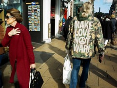 Make Love. (BadAlbert) Tags: streetphotography princesstreet edinburgh scotland citylife city urban candid canpubphoto people places street ricoh makelovenotwar