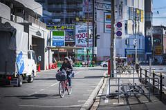 Bicycling in Osaka (Flutechill) Tags: street people urbanscene bicycle editorial citylife city japan outdoors cycling osakacity travel traffic osakaprefecture women transportation day modeoftransport walking citystreet osaka traveldestinations winter japaneseculture japanese