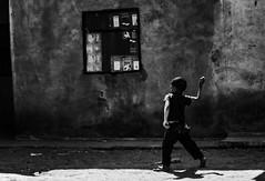 Fighting Back (Rod Waddington) Tags: madagascar malagasy boy blackandwhite streetphotography street stone culture cultural child antananarivo tana fighting back throw ethnic ethnicity