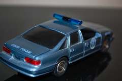 1996 Chevrolet Caprice Maine State Trooper Car. (dccradio) Tags: lumberton nc northcarolina robesoncounty car copcar policecar policecruiser statepolice statetrooper mainestatetrooper chevy chevrolet caprice cruiser indoor inside indoors tire tires wheel door doors reflection lightbar lawenforcement law diecast toy model replica 1996 blue vehicle transportation squadcar nikon d40 dslr